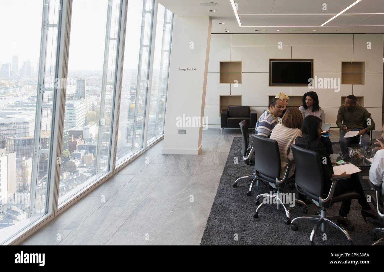 Business people talking in urban conference room meeting Stock Photo