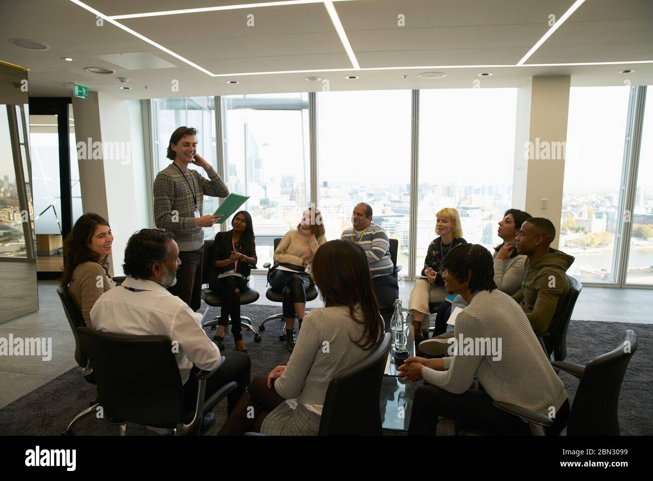 Business people meeting in circle in conference room Stock Photo