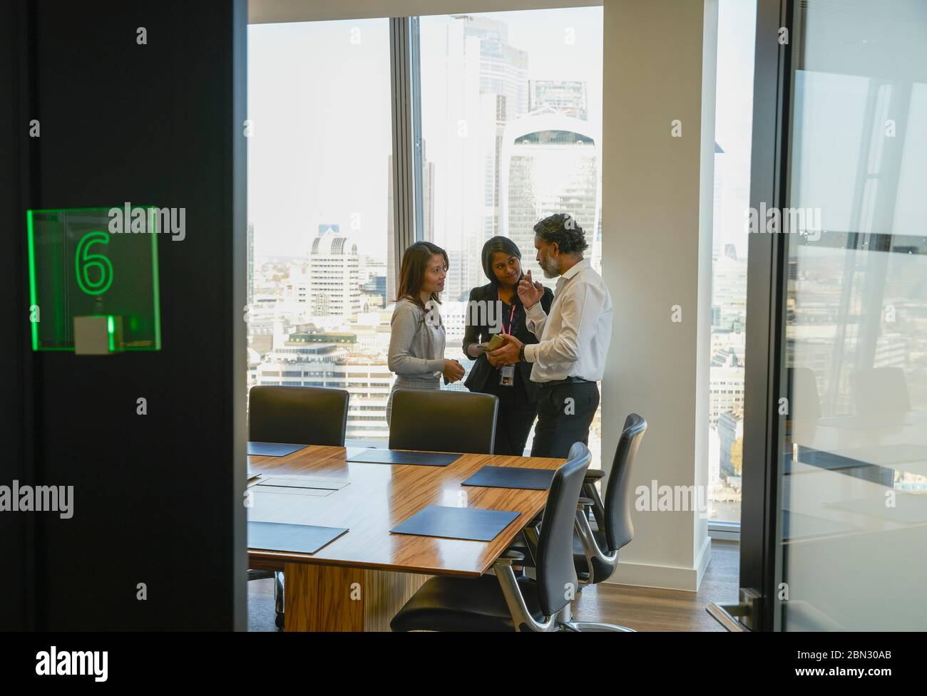 Business people talking in modern conference room meeting Stock Photo