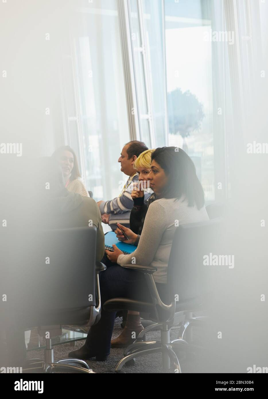 Business people talking in conference room meeting Stock Photo