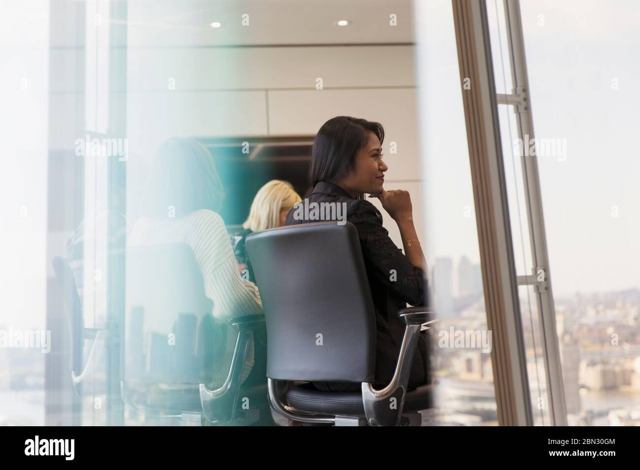 Business people in conference room meeting Stock Photo
