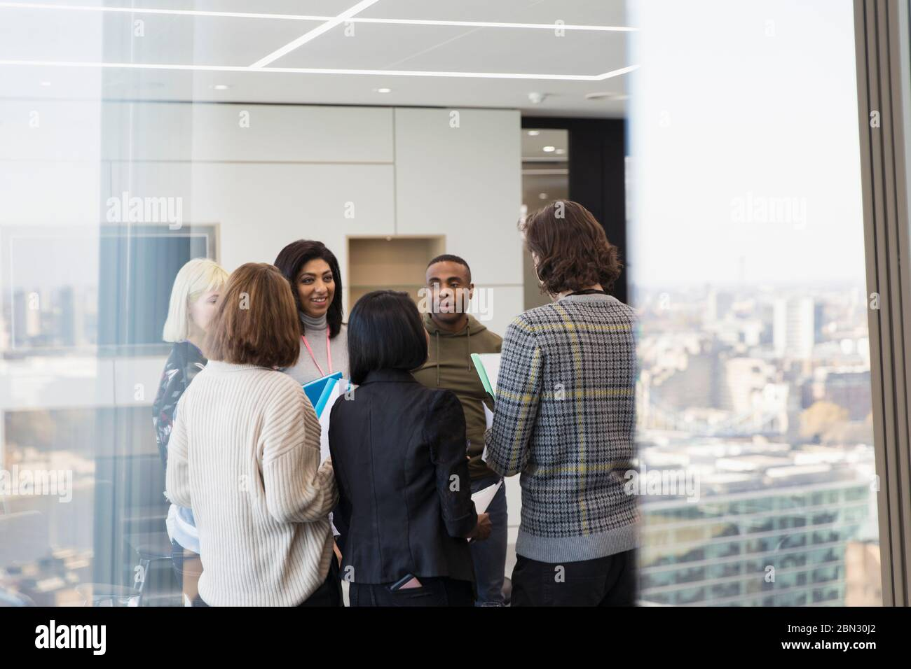 Business people talking in urban office meeting Stock Photo