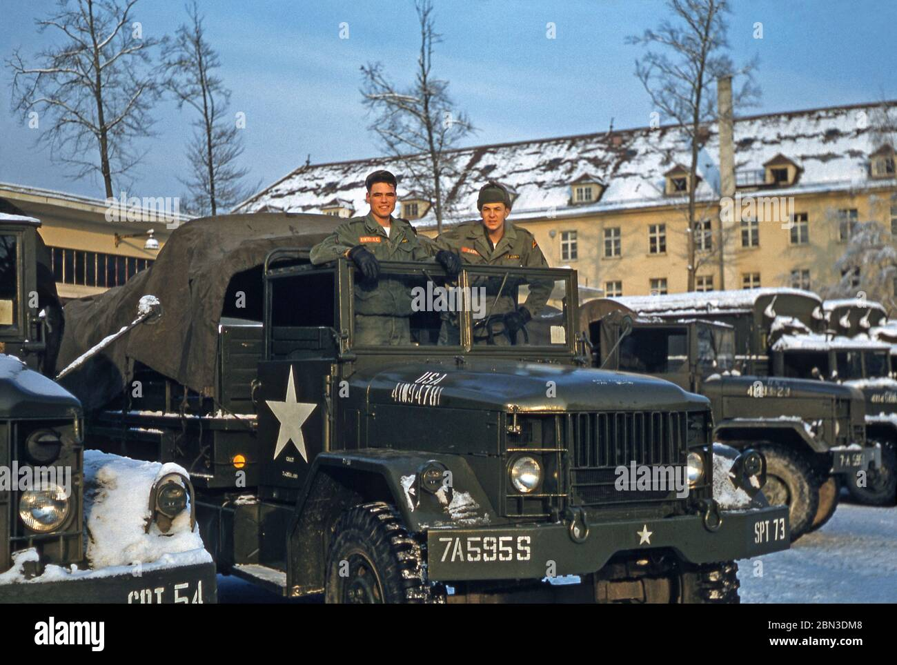 US Army soldiers stationed in Germany in the mid-1950s – two members of the 160th Signal Group are pictured on a military vehicle in the winter snow. From 1955 the 160th Signal Group provided communications throughout Germany under the US 7th (Seventh) Army during the Post-war era from an HQ at Panzer Kaserne (PK), in Böblingen (Boeblingen) near Stuttgart. The US 7th Army's HQ was at nearby Patch Barracks. Stock Photo