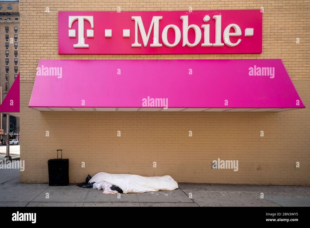 Homeless Individual Sleeps Next To A T Mobile Store In Midtown