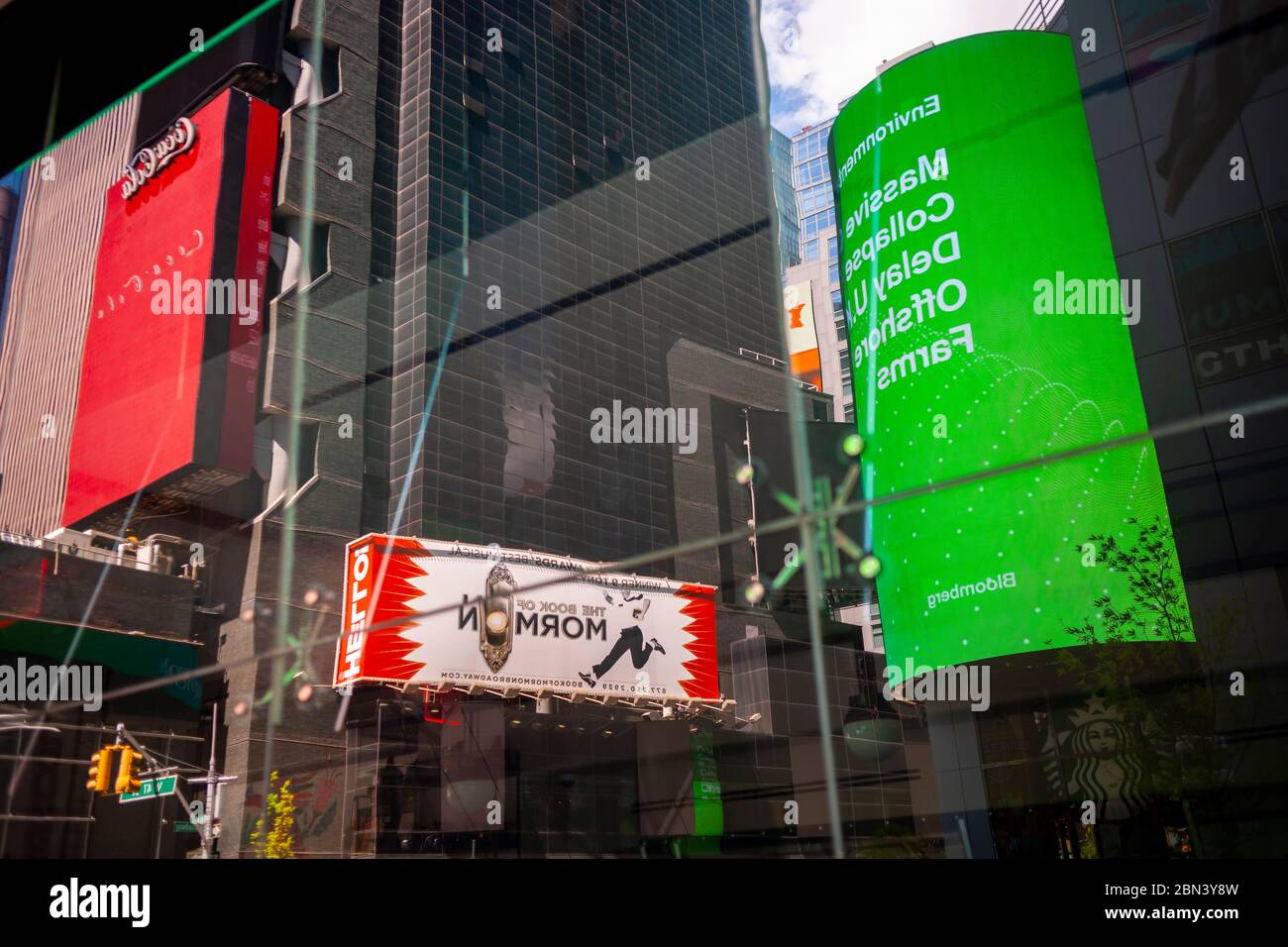 Billboards reflected in the window of a closed restaurant in an empty Times Square in New York during the COVID-19 pandemic on Thursday, May 7, 2020.  (© Richard B. Levine) Stock Photo