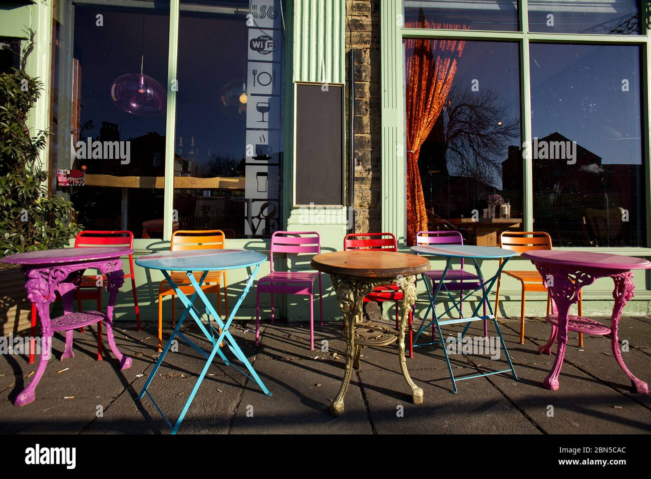Coloured Table And Chairs Outside A Vintage Cafe Stock Photo Alamy