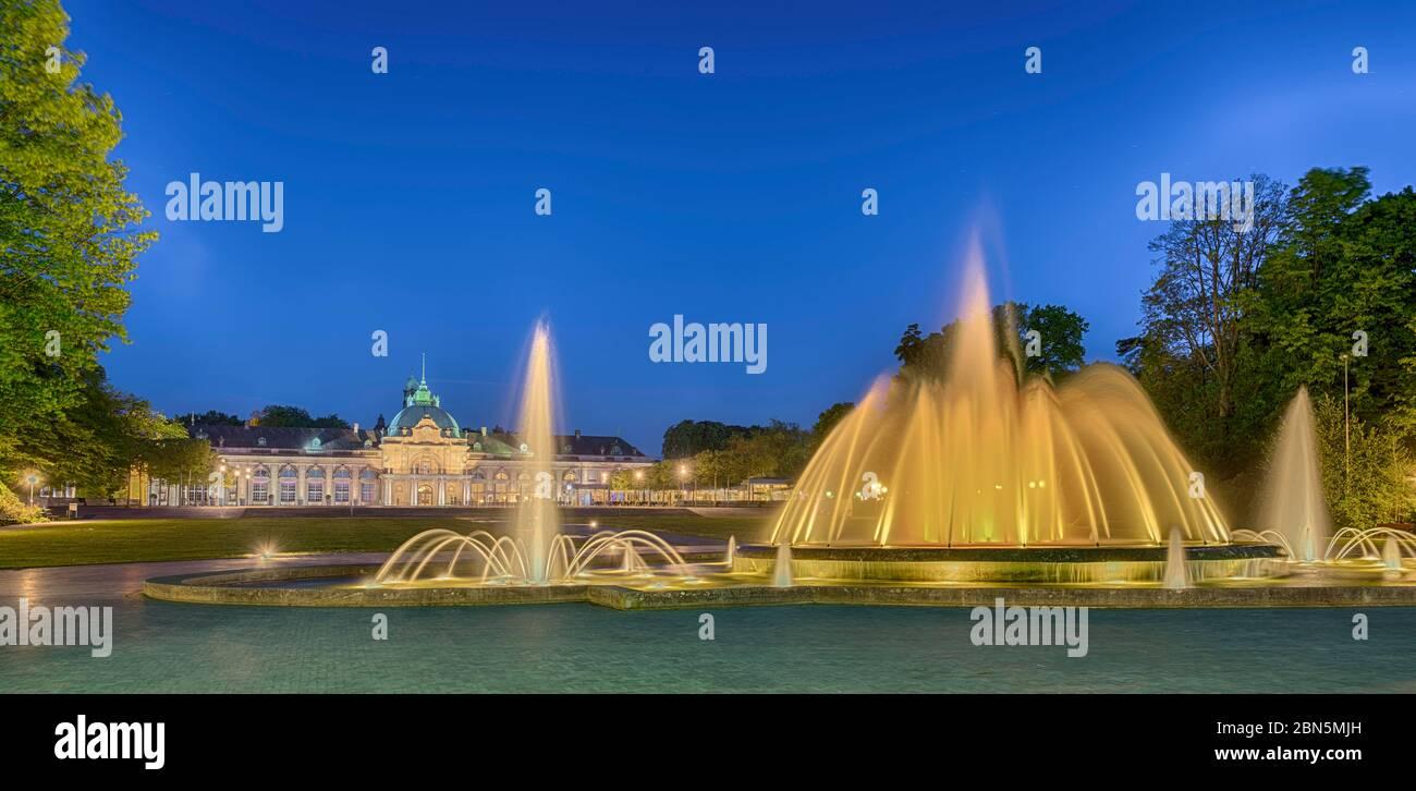 Spa garden with fountain, illuminated, Kaiserpalais, Bad Oeynhausen, Germany Stock Photo