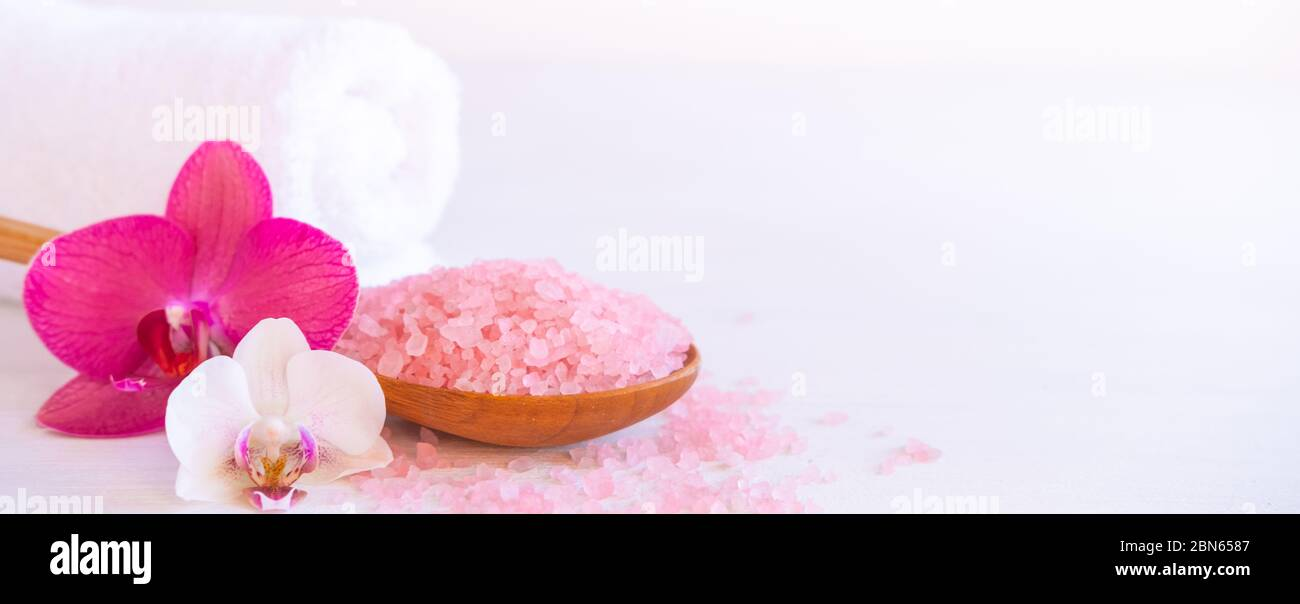 Banner Spa Cosmetic And Beauty Treatment Concept Pink Spa Sea Salt White Towel And Purple Orchid On White Wooden Background Copyspase Flatlay Stock Photo 357250999 Alamy