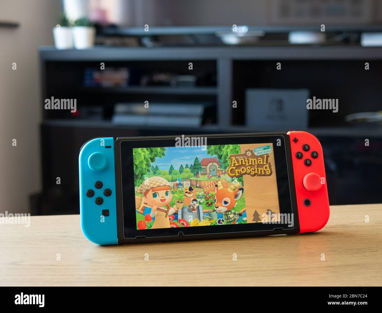 May 2020 Uk Nintendo Switch Console In Front Of Tv Unit With