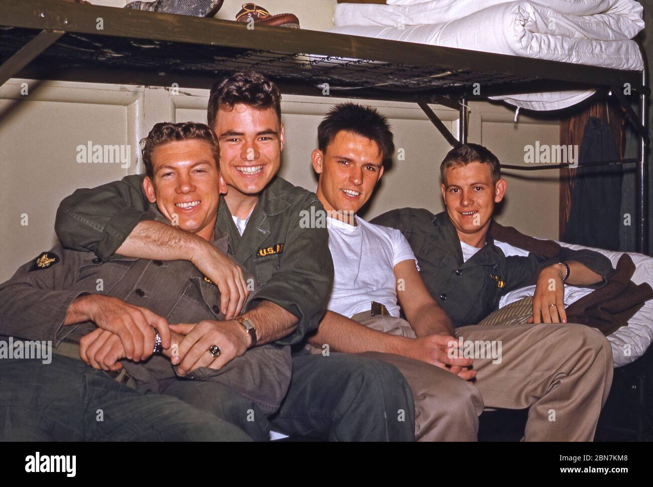 US Army soldiers stationed in Germany in the mid-1950s – four members of the 160th Signal Group are pictured on a bunk bed at the Panzer Kaserne (PK) headquarters, in Böblingen. From 1955 the 160th Signal Group provided communications throughout Germany under the US 7th (Seventh) Army during the Post-war era from an HQ at Panzer Kaserne (PK), in Böblingen (Boeblingen) near Stuttgart. The US 7th Army's HQ was at nearby Patch Barracks. Stock Photo