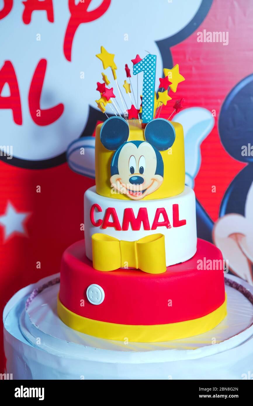 Aque one . Happy Birthday . One cake. Mickey Mouse . Red and yellow cake. Azerbaijan Baku 14.02.2020 . Stock Photo
