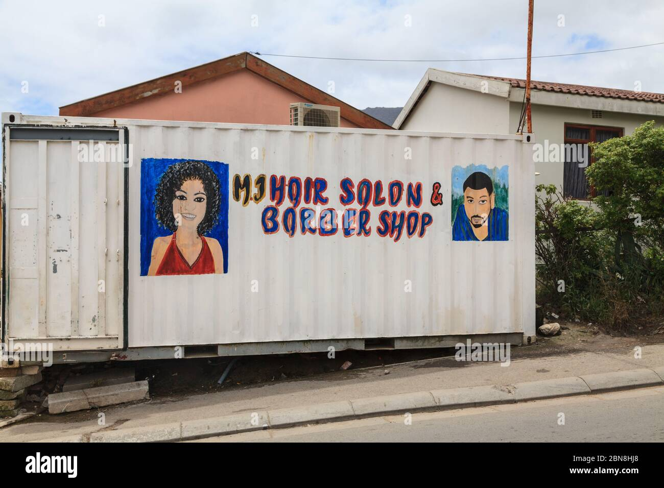 Hairdresser, improvised hair salon and barber shop in container, exterior, Imizamo Yethu Township (Mandela Park) settlement, Cape Town, South Africa Stock Photo