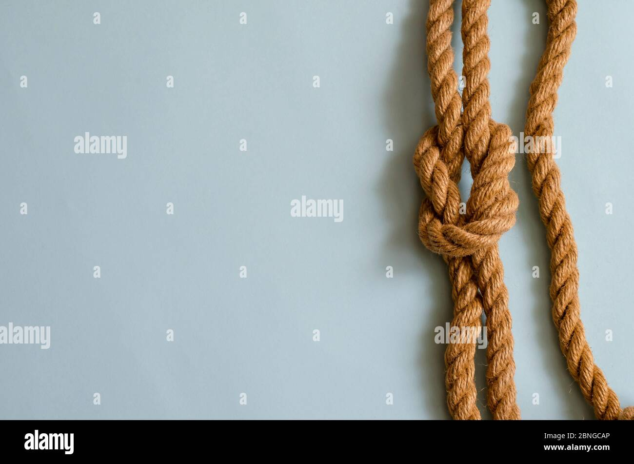 Hemp Rope With A Nautical Knot On A Light Blue Background Knotted Natural Rope Sea Travel Beach Vacation Fishing Multitask Background For Design Stock Photo Alamy