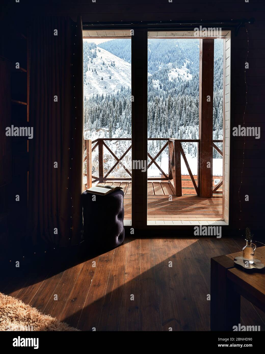 Cozy Living room in the wooden house with terrace in the mountains Stock Photo