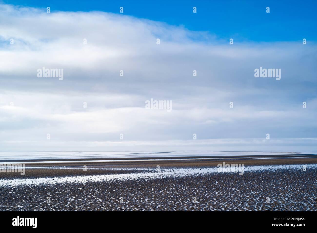 Pastel shades of sea and sandy beach of the Bristol Channel at Burnham-on-Sea seashore, Somerset, UK Stock Photo