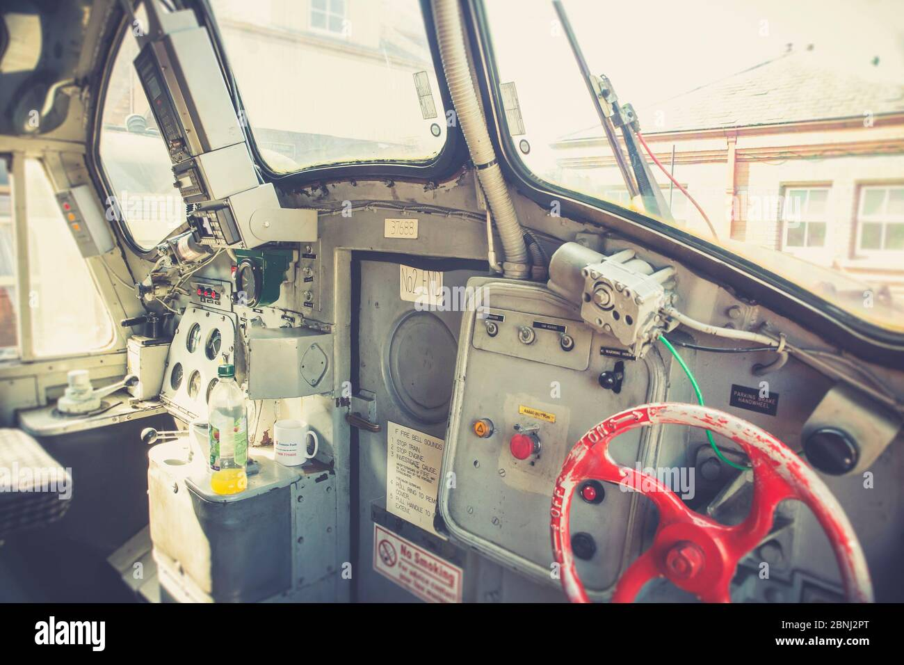Retro view close up of train controls inside vintage UK diesel locomotive cab. At the driver controls of BR Class 37 Great Rocks diesel-electric loco. Stock Photo