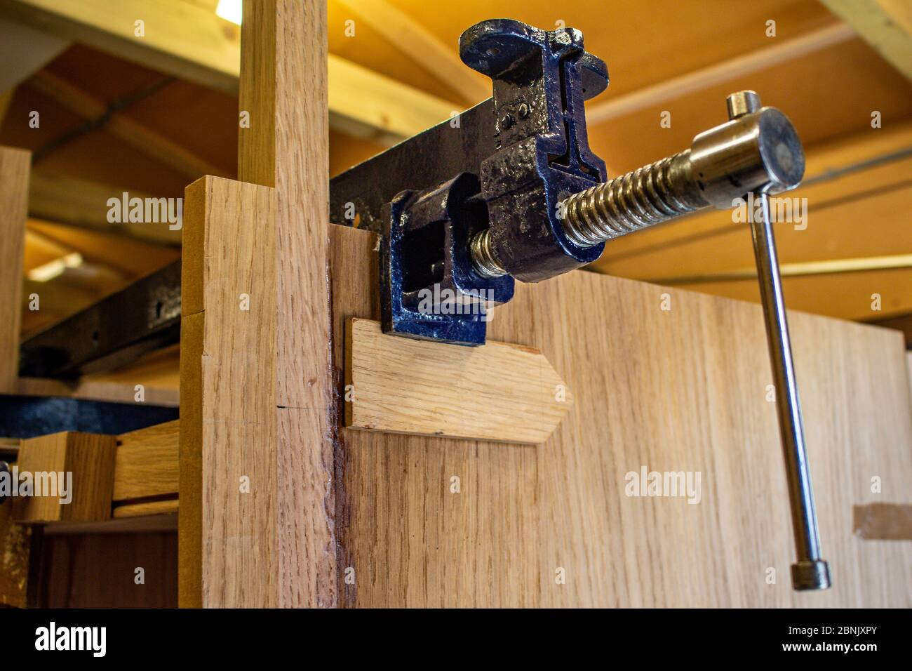 Woodworking Clamps Being Used To Clamp Wood While Glue Dries Stock Photo Alamy