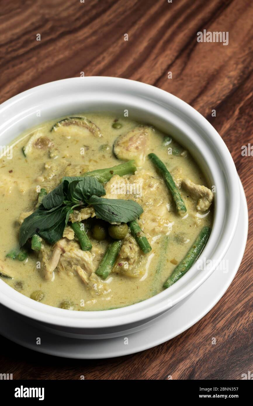 thai green curry with chicken and vegetables on wood table Stock Photo