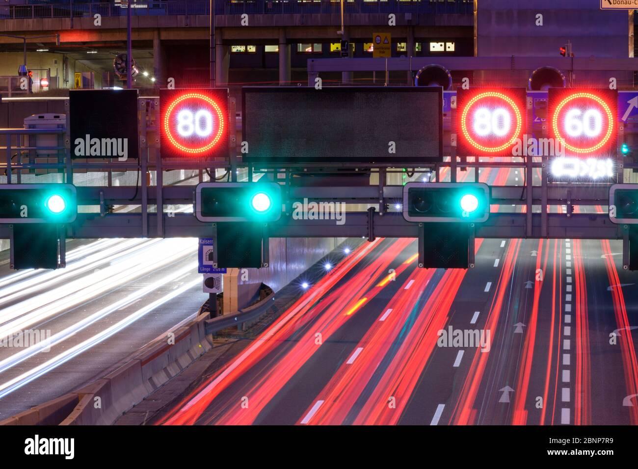 Vienna, Autobahn A22 Donauuferautobahn, light trails, traffic jam sign, speed limit, 22. Donaustadt, Vienna, Austria Stock Photo