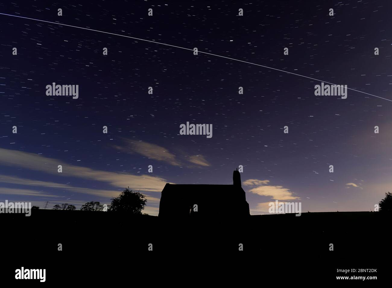 St Mary's Chapel near Tadcaster with a pass from the International Space Station Stock Photo