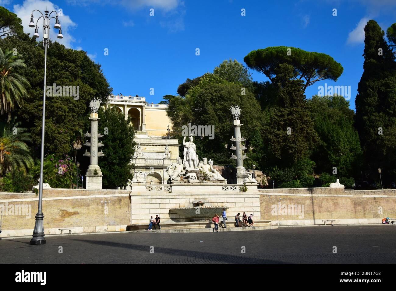 Piazza del Popolo with the Fontana della Dea di Roma, looking up at the Baclonata del Pincio in the city of Rome, Italy Stock Photo