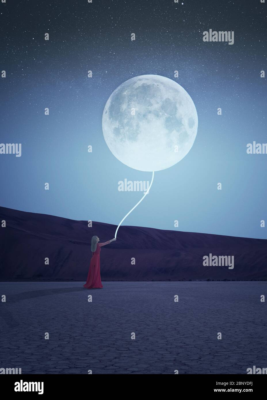 Night scene of a woman in red dress holding a glowing rope attached to a moon in the sky. Fantasy Stock Photo