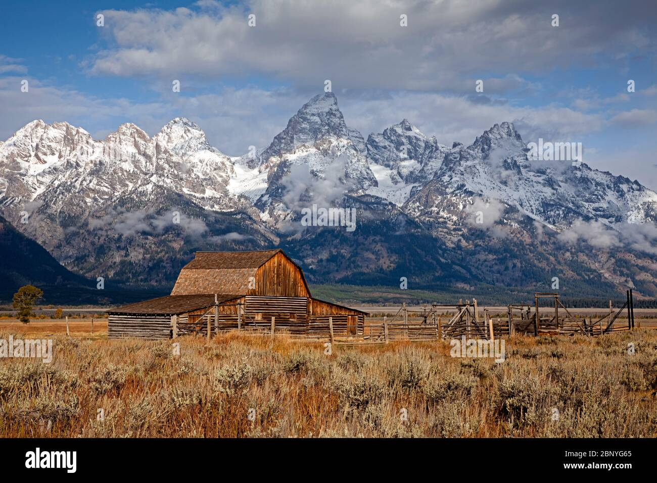 WY04365-00....WYOMING - HIstoric John Moulton barn on Mormon Row with the Grand Teton froming a dramatic background in Grand Teton National Park. Stock Photo