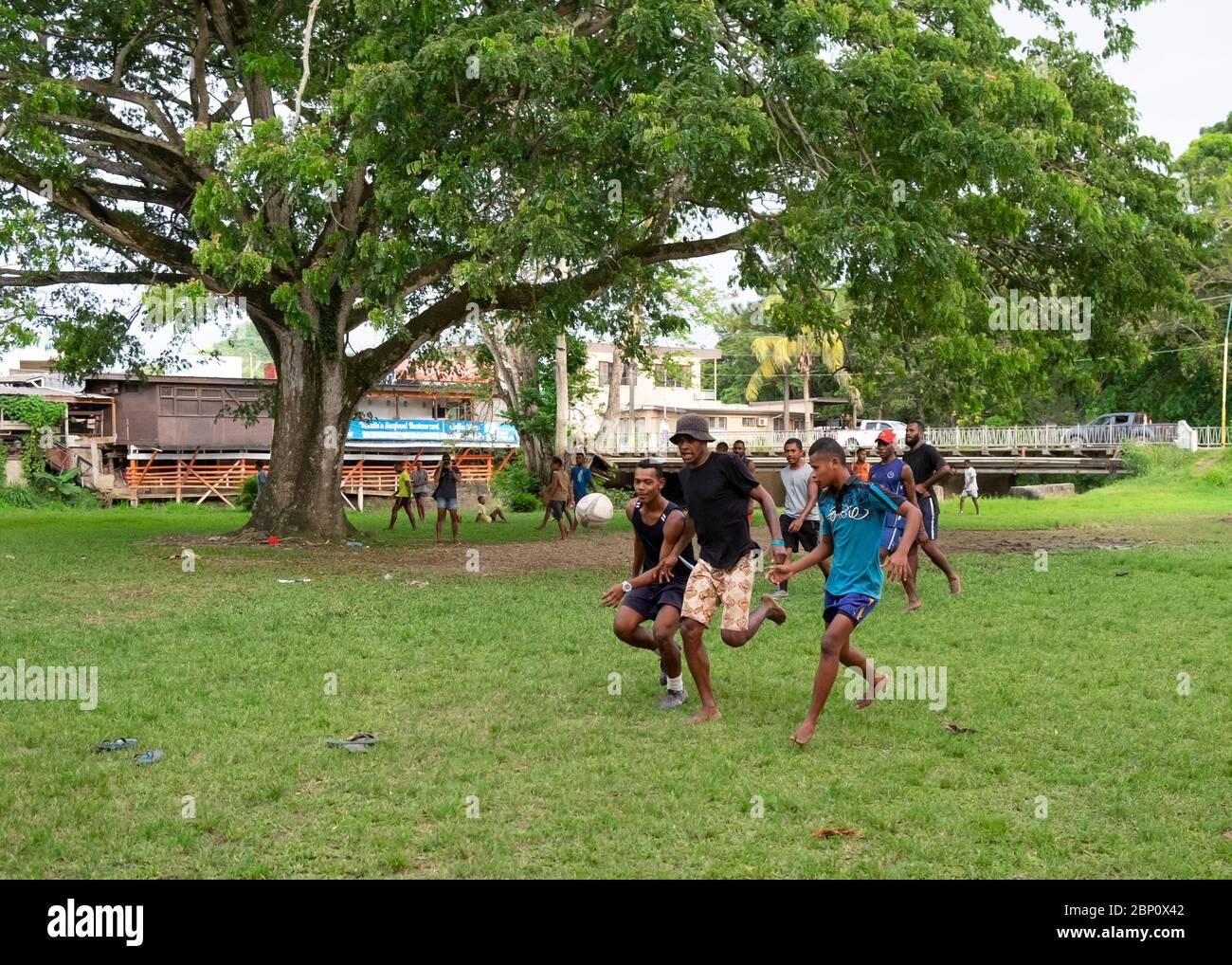 Fijian men play rugby in the local park in Sigatoka (Singatoka), Fiji. Stock Photo