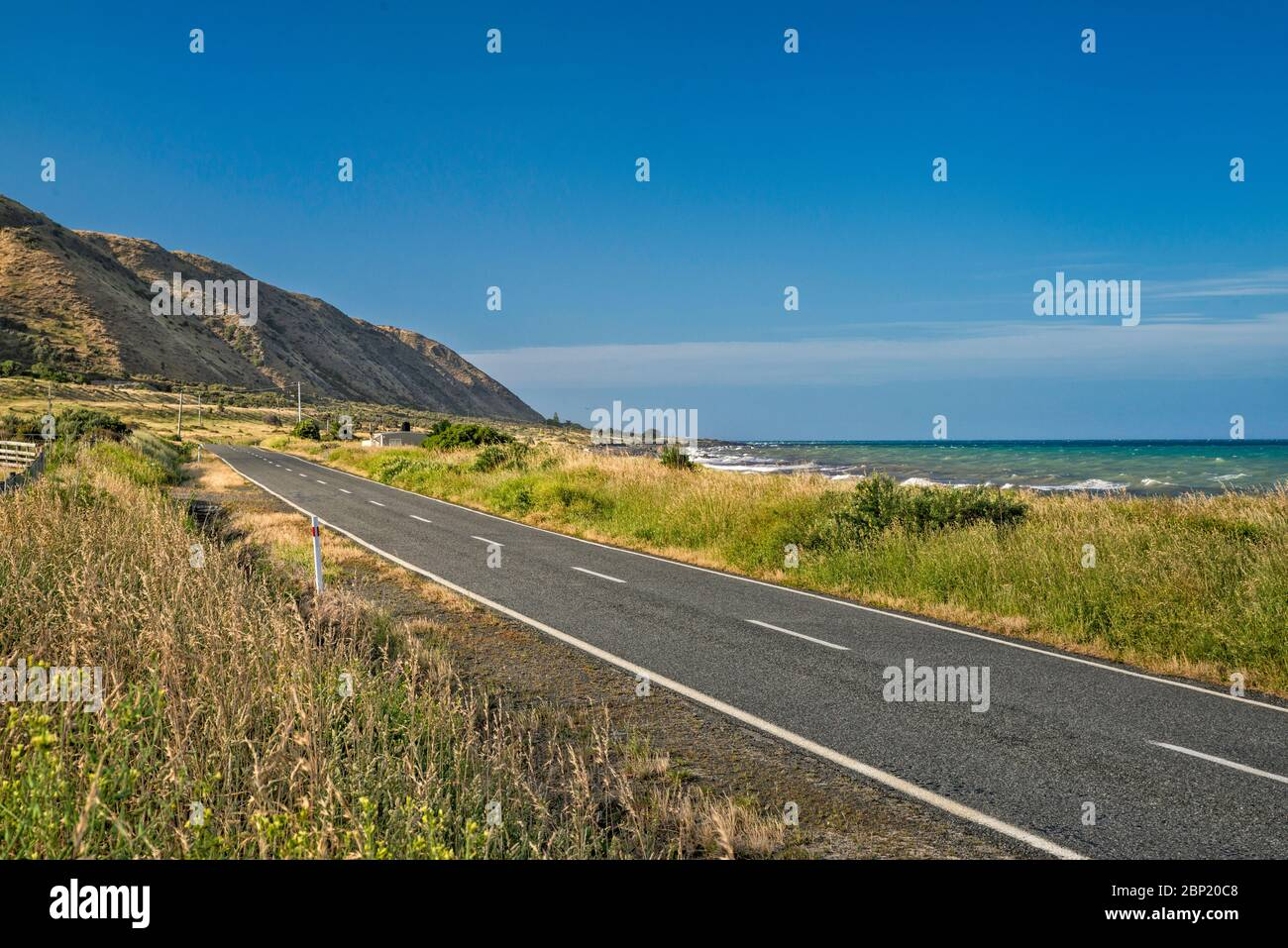 Cape Palliser Road near Te Humenga Point, South Wairarapa Coast, Palliser Bay, Cook Strait, Wellington Region, North Island, New Zealand Stock Photo