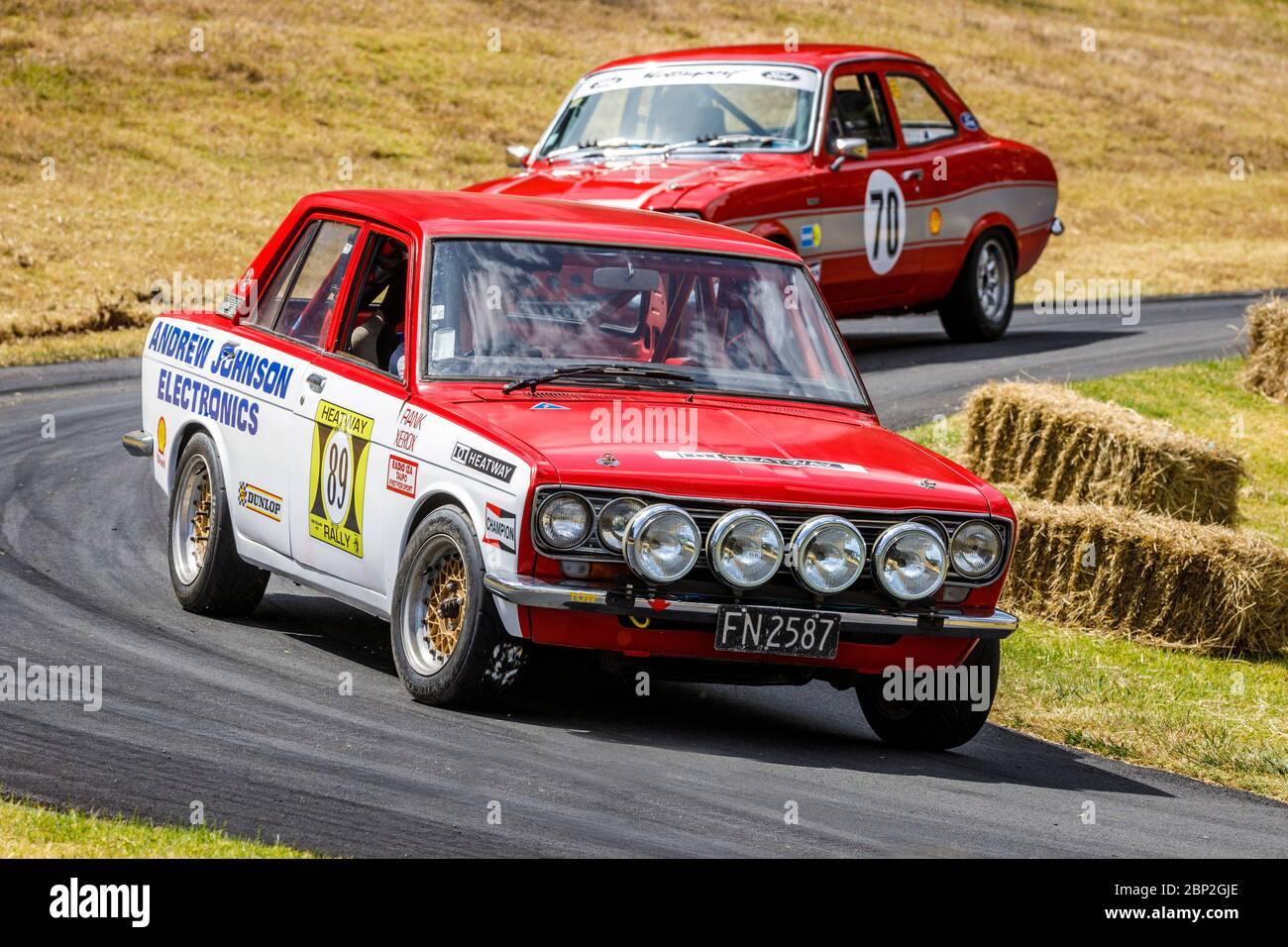 Andrew Johnson in his 1972 Heatway Rally Datsun 1600 restored to original livery. Stock Photo