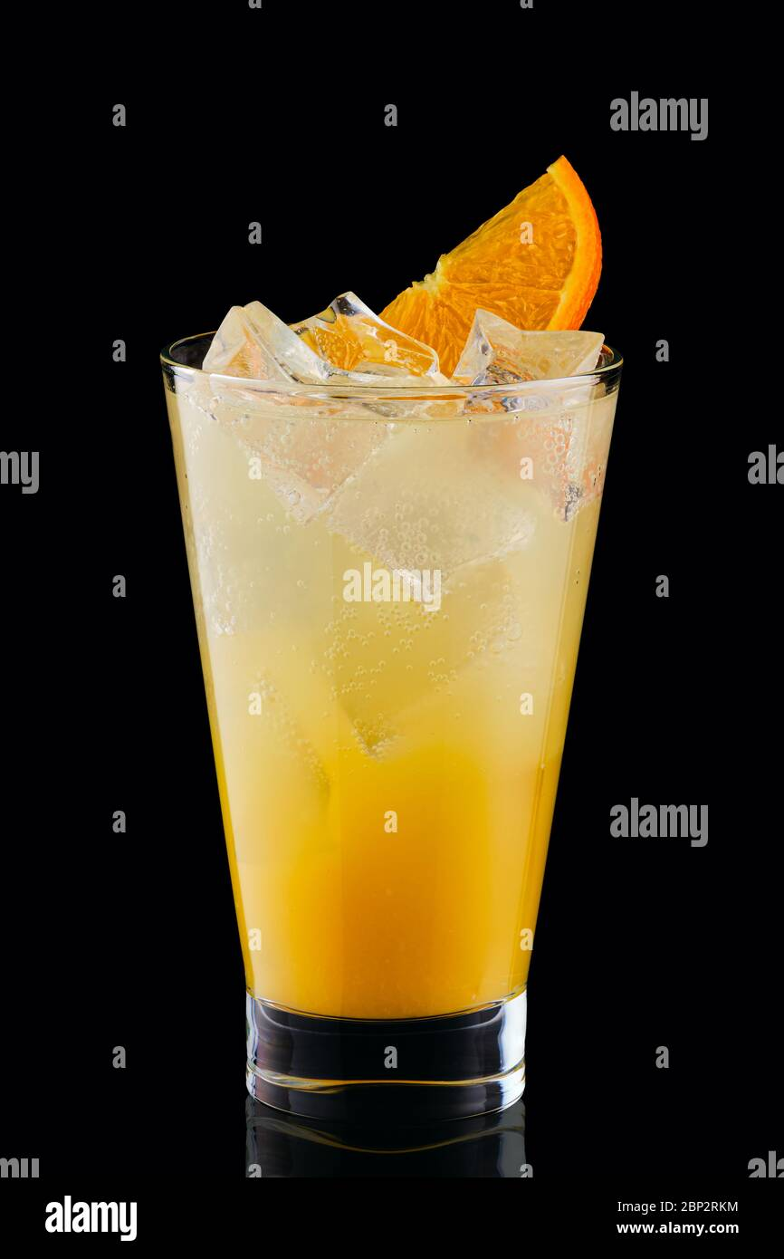 Cold fizz cocktail with orange isolated on black background Stock Photo