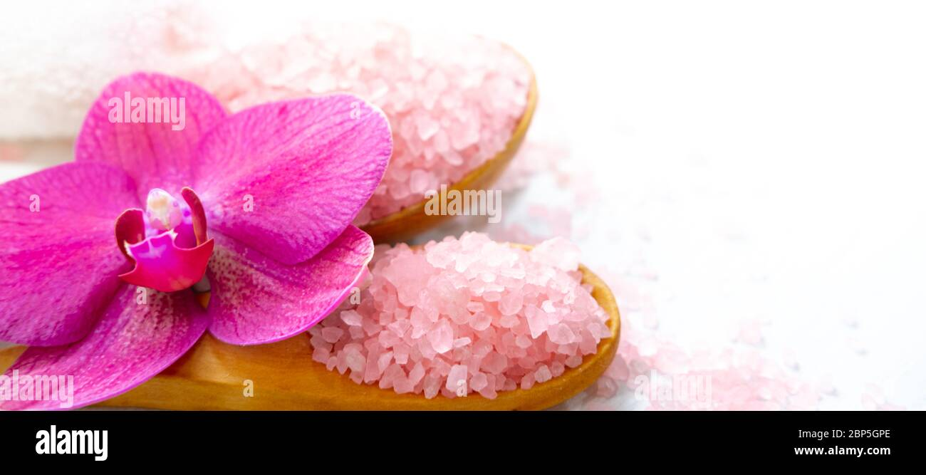 Banner Spa Cosmetic And Beauty Treatment Concept Pink Spa Sea Salt White Towel And Purple Orchid On White Wooden Background Copyspase Flatlay Stock Photo Alamy