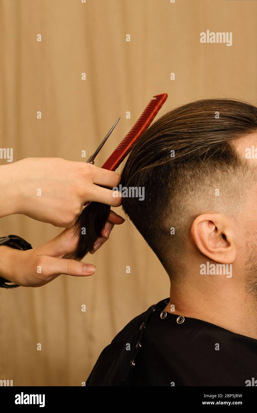 Men Haircut Fashionable Hairstyle Barber Using Scissors And Comb Hairdresser Cutting Man Hair Barbershop Stock Photo Alamy