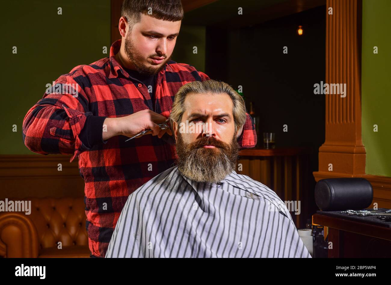 Donate Hair Donation And Charity Concept Guy With Dyed Blond Hair Cut Hair Barber Hairstyle Barbershop Hipster Getting Haircut Sharp Object Near Face And Squirming Distracts Person Holding It Stock Photo