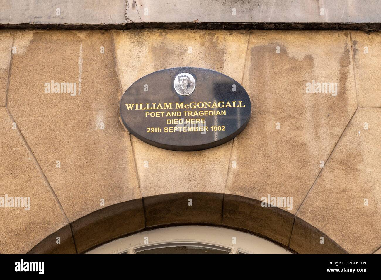 Commemorative plaque for William McGonagall poet and tragedian on building where he died in South College Street, Edinburgh, Scotland, UK Stock Photo