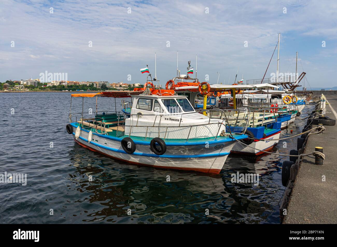 NESSEBAR, BULGARIA - JUNE 22, 2019: Pleasure and fishing boats on the pier of the old town. Nesebar is an ancient city and one of the major seaside resorts on the Bulgarian Black Sea Coast. Stock Photo