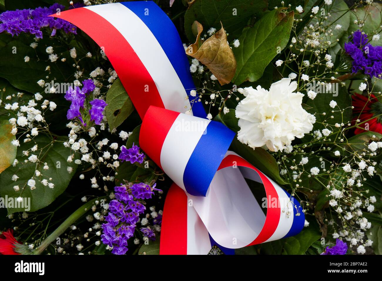 Spray of flowers, miliary memorial, Inimond, Bugey massif, Ain, France Stock Photo