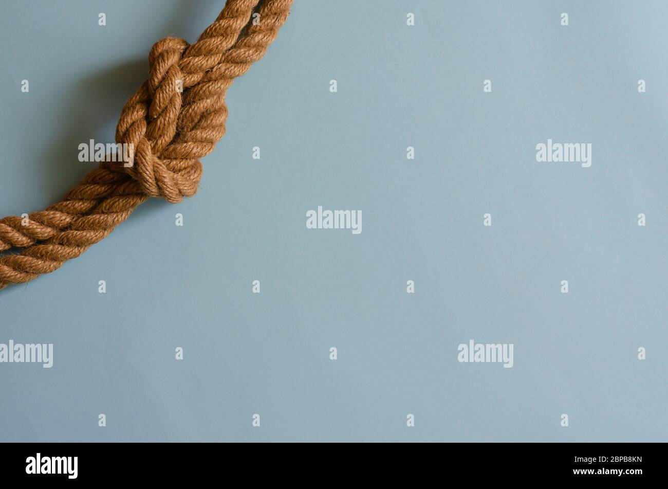Hemp Rope With A Nautical Knot On A Light Blue Background Knotted Natural Rope Multitask Background For Design Tasks Place For Text Stock Photo Alamy