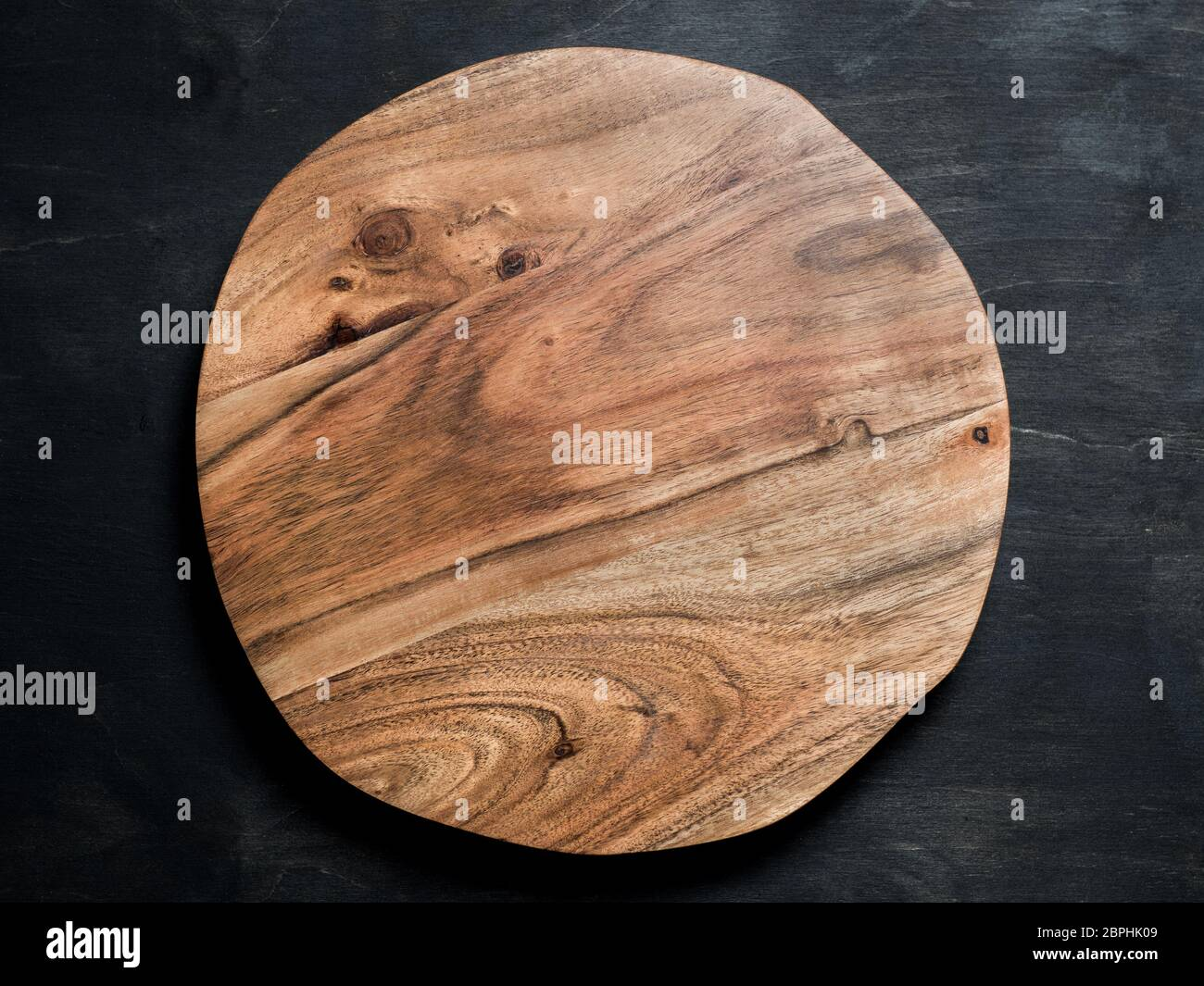 Round Wooden Tray Or Cutting Board On Black Table Top View Of Empty Kitchen Trendy Rustic Wooden Tray Saw Cut Imitation On Black Wooden Background C Stock Photo Alamy