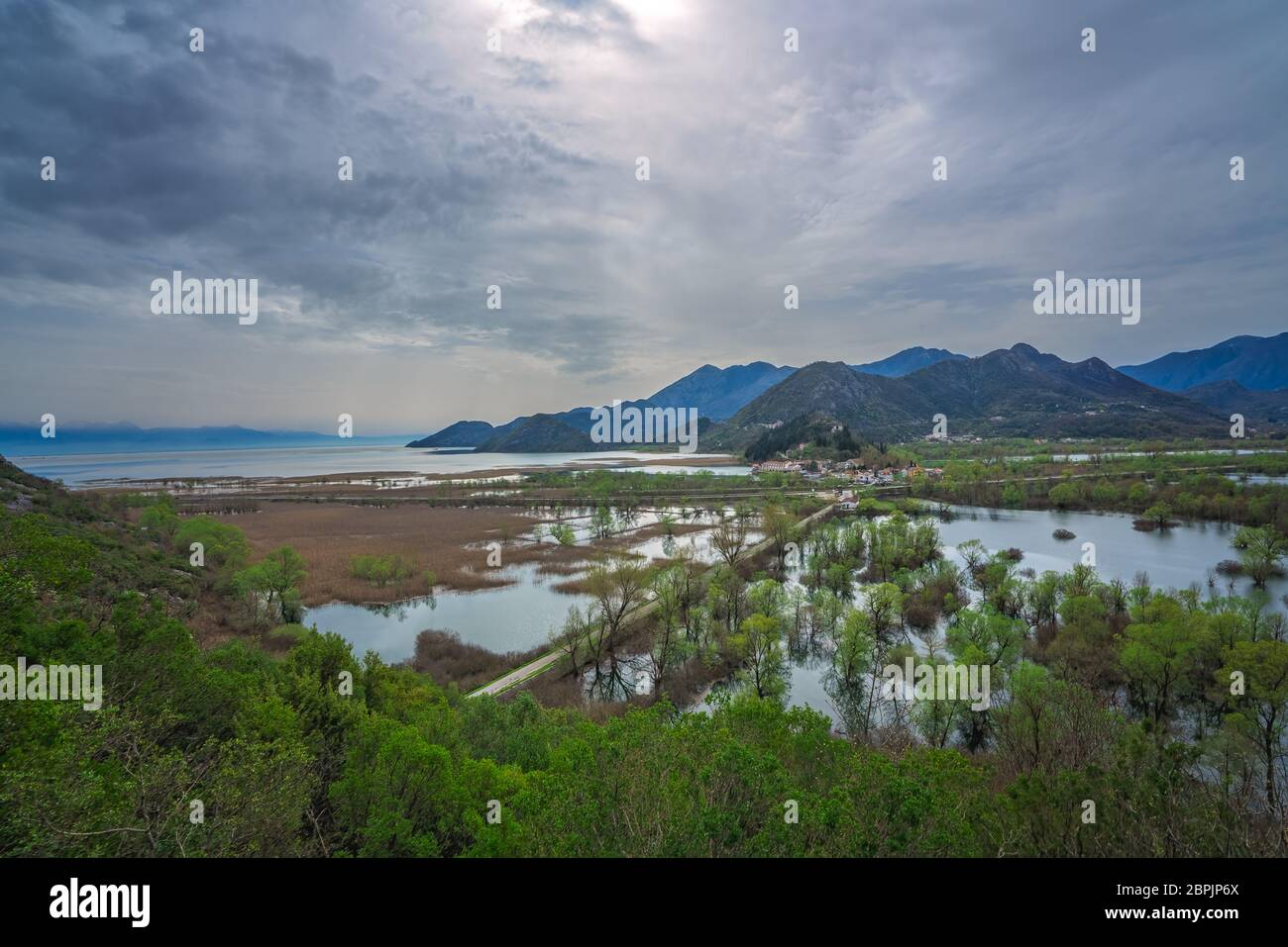 Buildings in small Virpazar town seen from above, Skadar Lake National Park, Montenegro Stock Photo