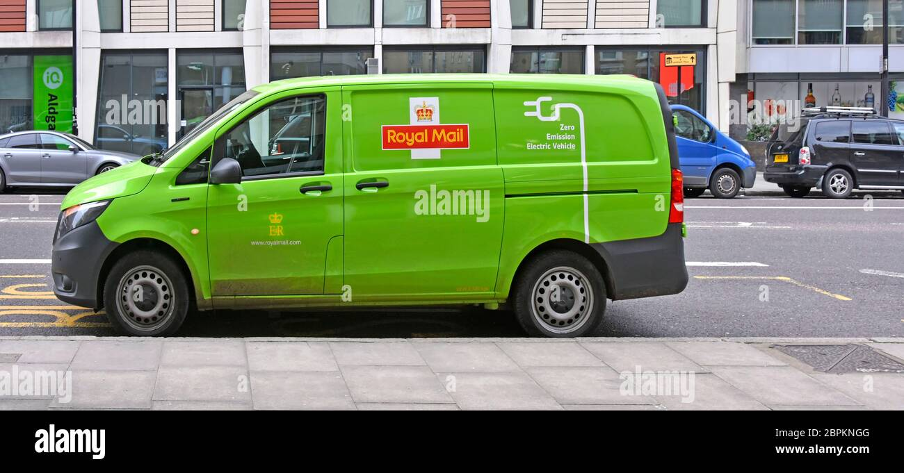 View Of Green Coloured Royal Mail Zero Emissions Electric Post Delivery Van With Graphics This Side Back With Standard Red Opposite Side London Uk Stock Photo Alamy