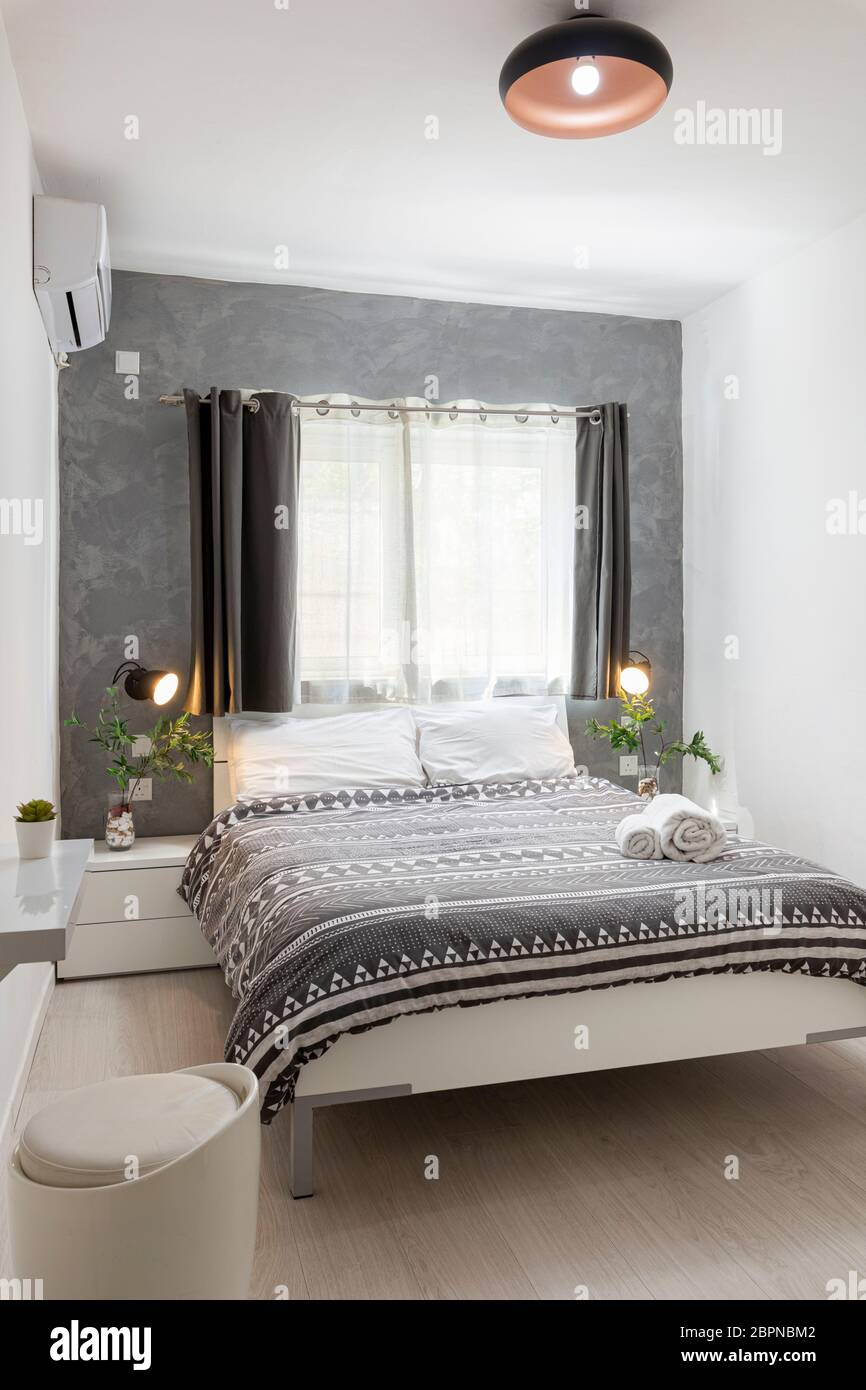 St Julians Malta April 28th 2020 Small Bright Double Bedroom With Grey Decor And Simple Clean Walls Stock Photo Alamy
