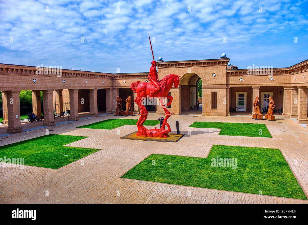 red knight and horse with plaza background at the Masone Labyrinth Museum in Fontanellato - Parma - Italy Stock Photo