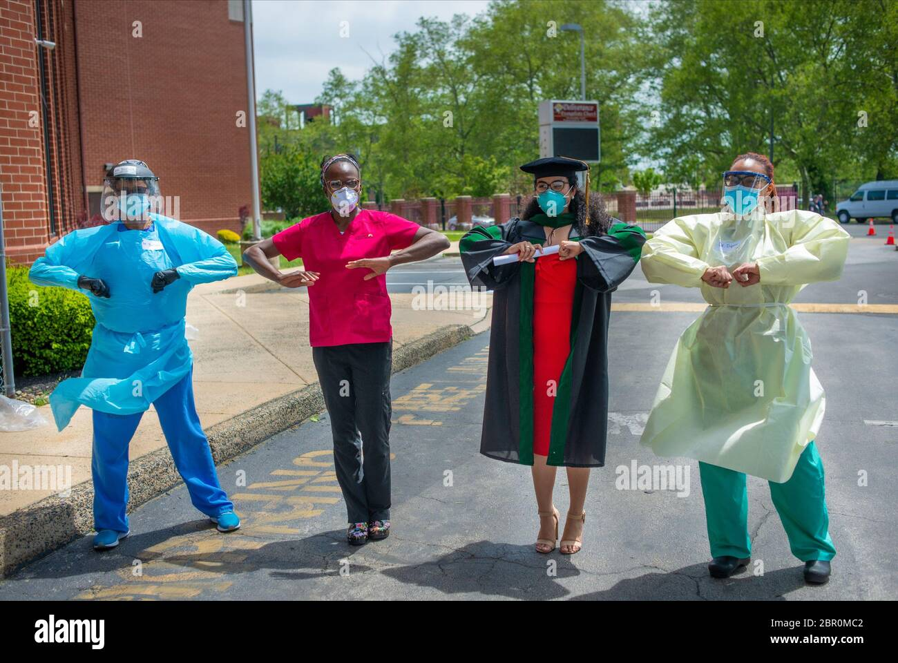 Philadelphia, Pennsylvania, USA. 19th May, 2020. Dr. Ala Stanford (2nd from left), a pediatric surgeon at Abington Jefferson Health and newly graduated Dr. Natalie Anne Gonzalez (3rd from left) from PCOM along with two other doctors pose for a photo during a break in testing patients for COVID-19 Tuesday, May 19, 2020 at Deliverance Evangelistic Church in Philadelphia. Since very early on in the pandemic, Dr. Ala Stanford and her organization, Black Doctors COVID-19 Consortium, has been taking COVID-19 testing for free into the African American communities inland surrounding Philadelphia. Cred Stock Photo