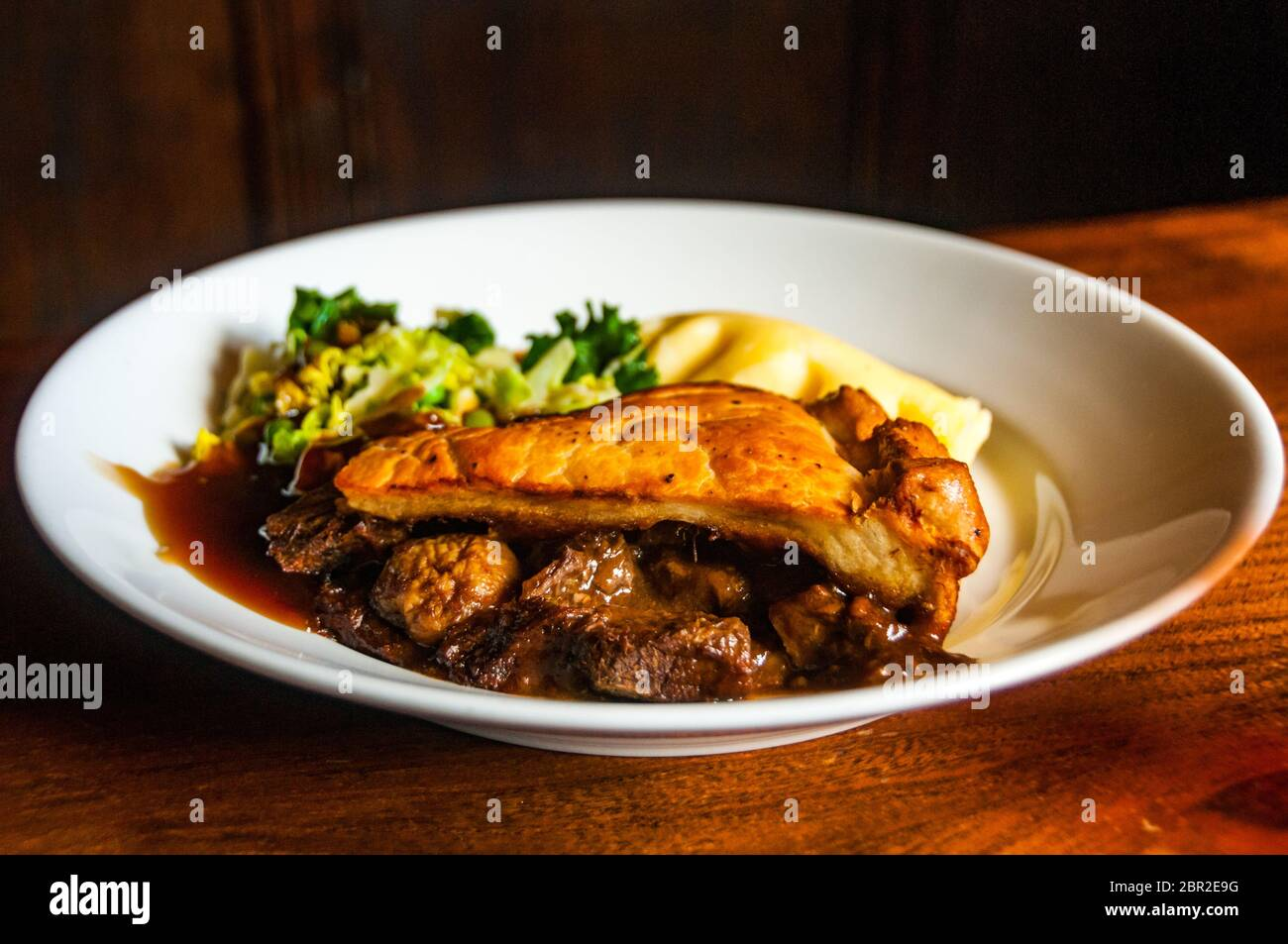 A steak and mushroom pie at the High Corner Inn at Linwood in the New Forest. Stock Photo