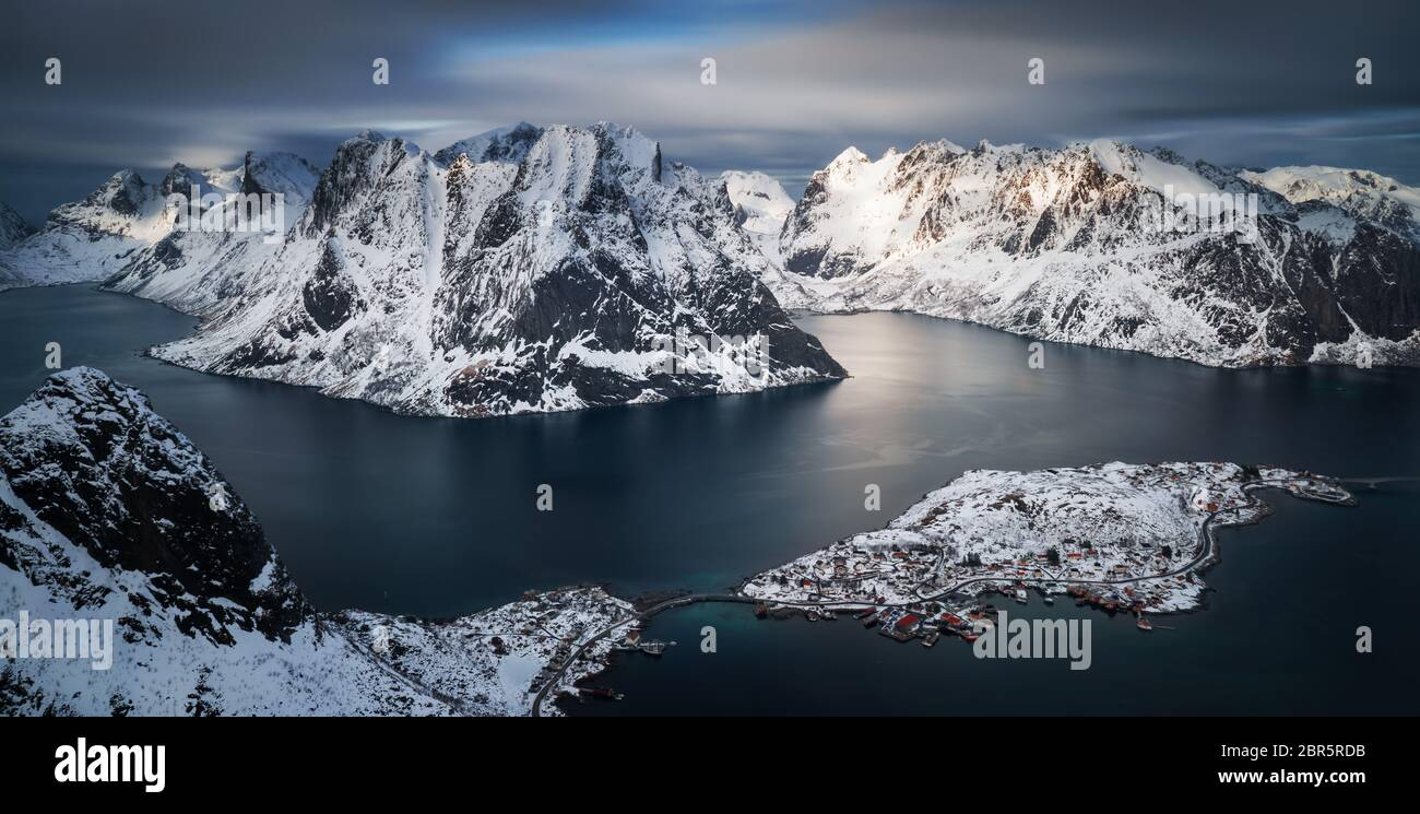View from Reinebringen summit on Andoya and Olstinden in snowy winter, Lofoten Stock Photo