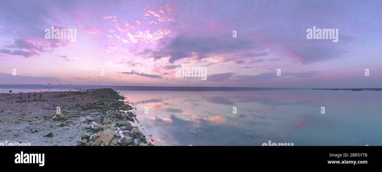 Panoramic View Of The Clouds Above The Water In A Pink And Purple Sunset Stock Photo Alamy