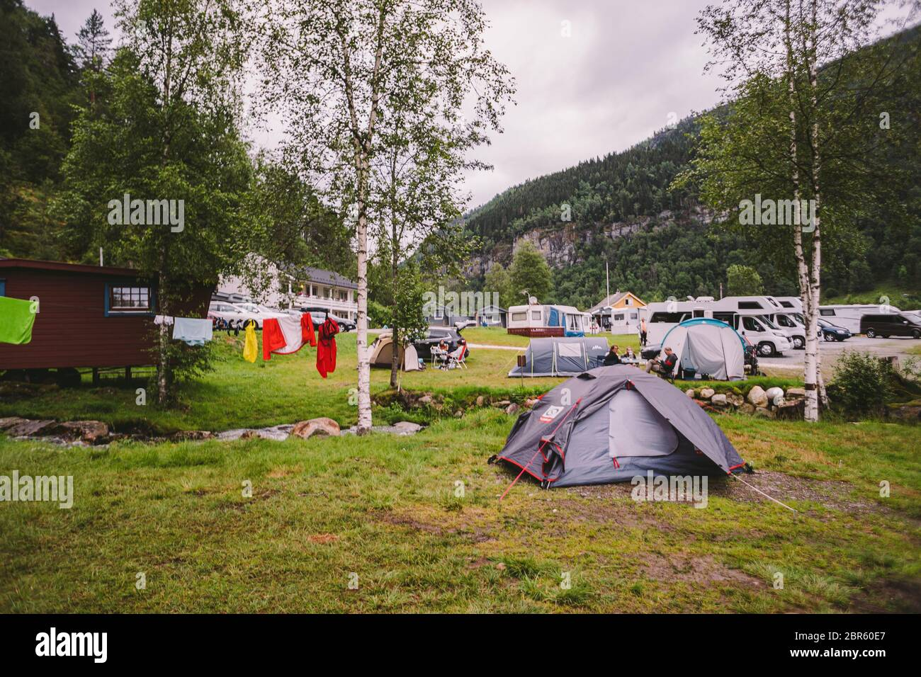 Tvinde Camping tents on the background of a waterfall Tvindefossen in Norway near Voss July 23rd, 2019. Campsite in the norwegian fjords Stock Photo