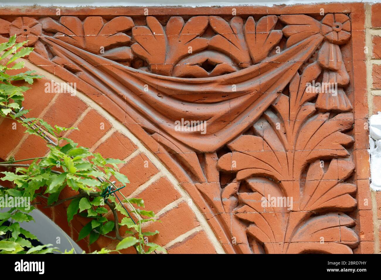 Terracotta decoration on housing on Ritherdon Road, Heaver Estate, Tooting, London, UK Stock Photo