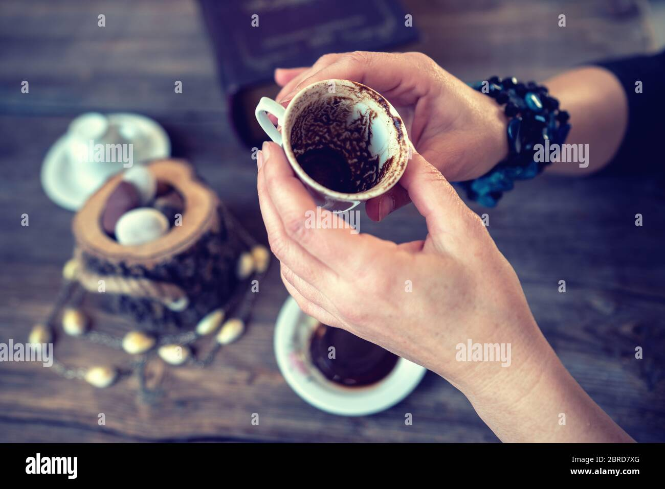 woman hold the mug and telling fortune with traditional turkish coffee cup Stock Photo